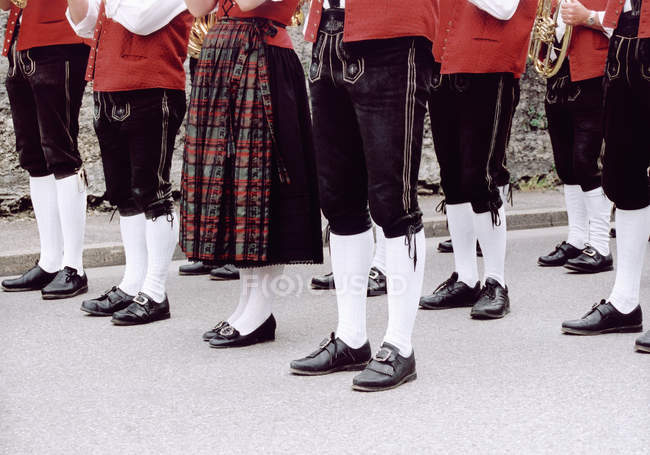 Low section of people wearing traditional costumes — Stock Photo