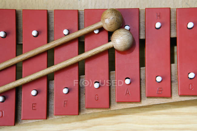 Close up view of xylophone and with wooden mallets — Stock Photo
