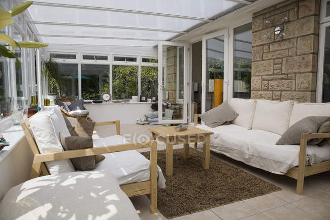 Interior view of lounge area of conservatory — Stock Photo