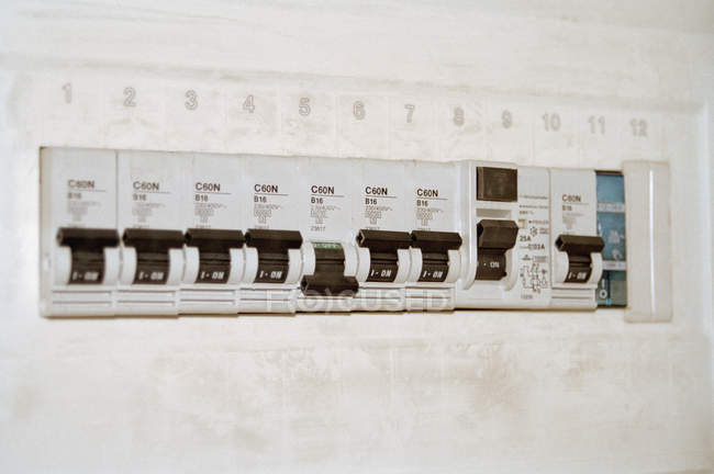 Row of plastic switches in fuse box — Stock Photo