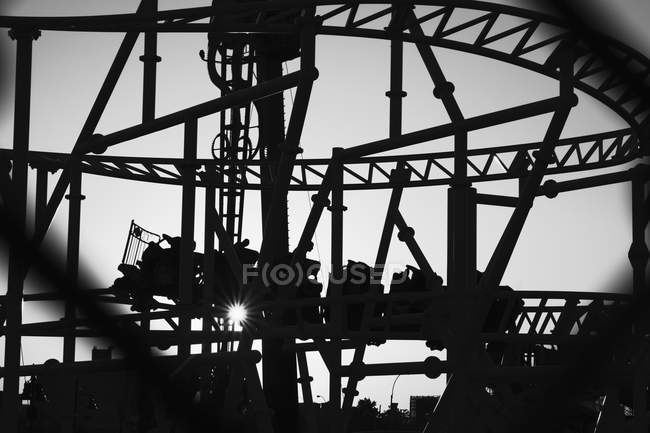 Silhouette of roller coaster van on move — Stock Photo