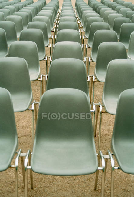 Perspective view of rows of empty chairs — Stock Photo