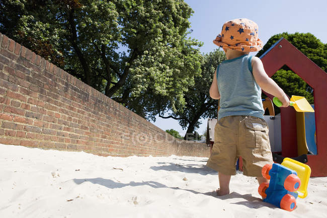 Little boy playing with toys at playground — Stock Photo