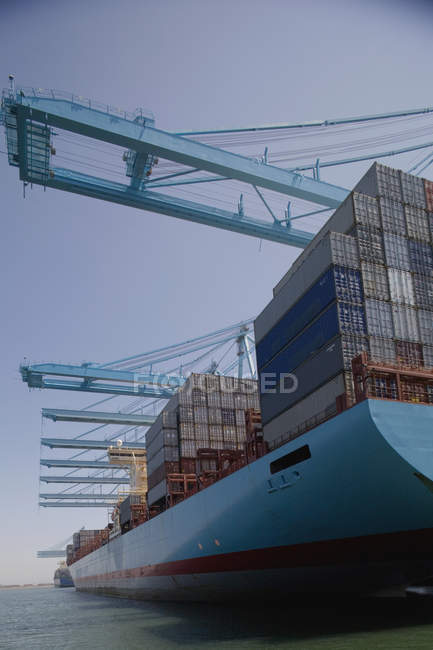 Cargo containers stacked on commercial dock — Stock Photo