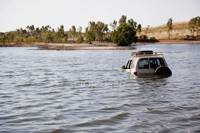 4x4 vehicle driving through deep water at nature — Stock Photo