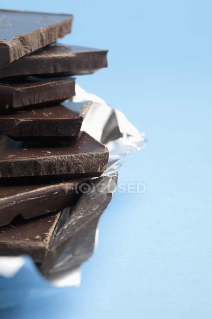 Cropped image of stackes dark chocolate — Stock Photo