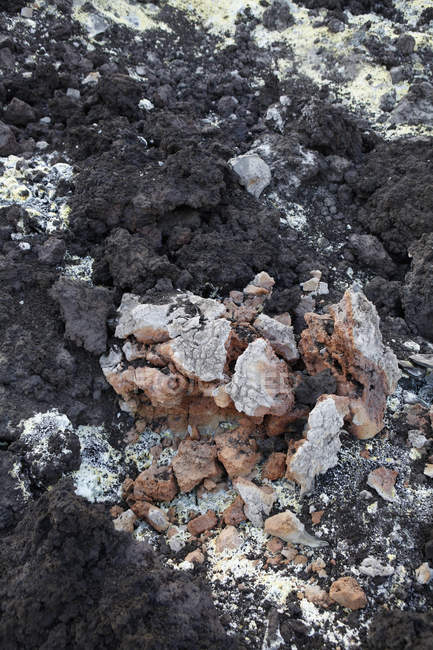 Close up view of sulfur deposits on black rocks — Stock Photo