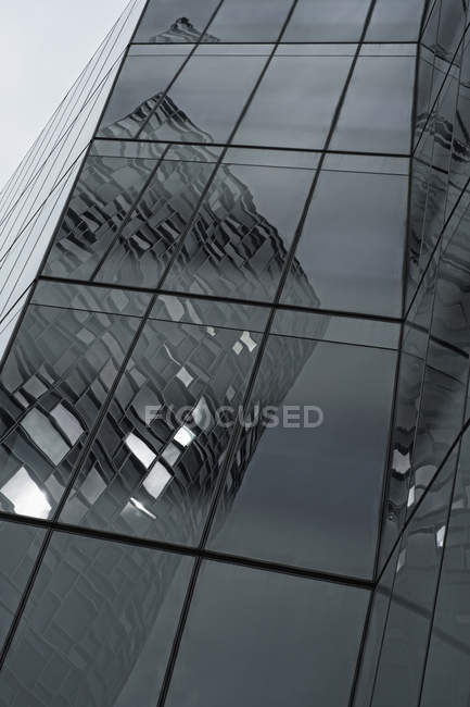 Exterior of facade with skyscraper's bent reflections — Stock Photo