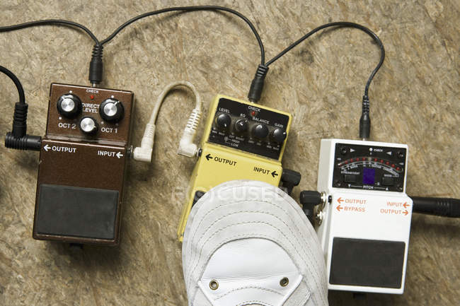 Crop foot pressing guitar effect pedals — Stock Photo