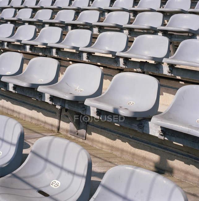 Rows of empty seats in stadium — Stock Photo