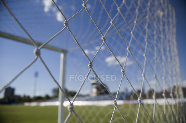 Close up view of soccer goal net on sunny day — Stock Photo