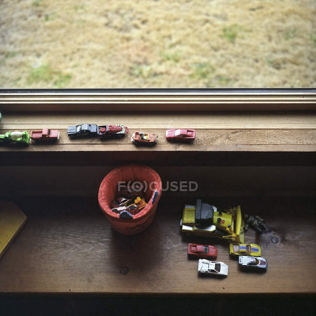 A collection of toy cars on a window sill — Stock Photo