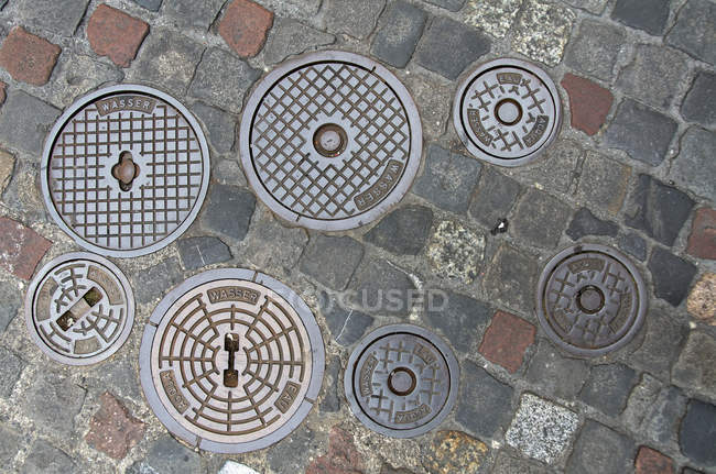 From above view of manhole covers — Stock Photo
