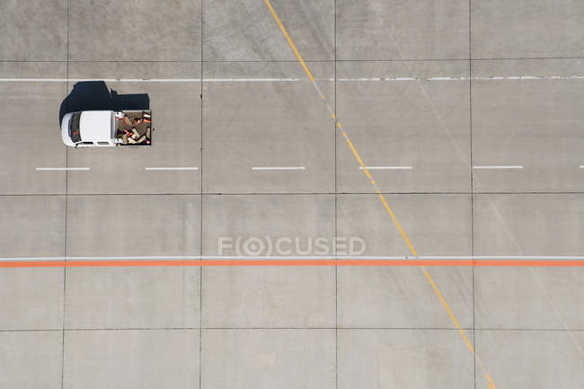 Aerial view of van driving across airport tarmac — Stock Photo