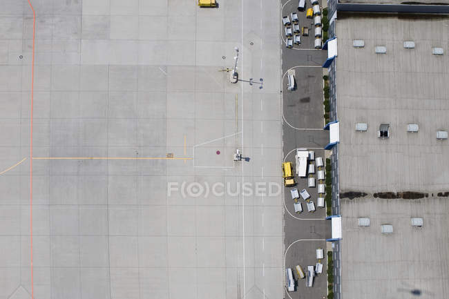 Aerial view of empty airport tarmac and luggage carts — Stock Photo