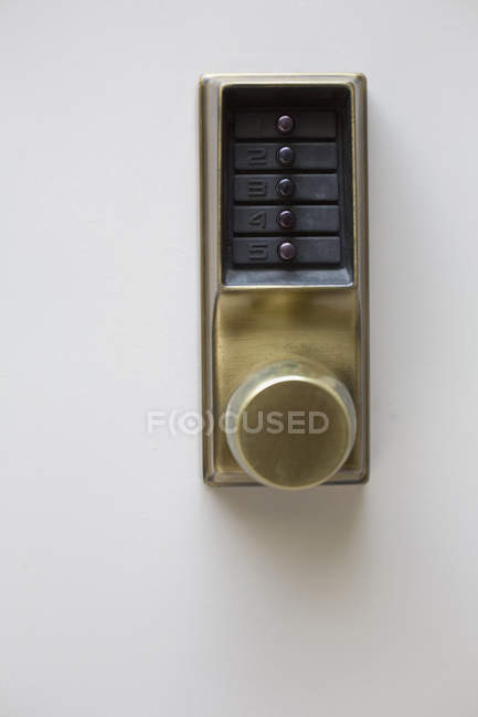 Door handle and electronic lock with buttons — Stock Photo