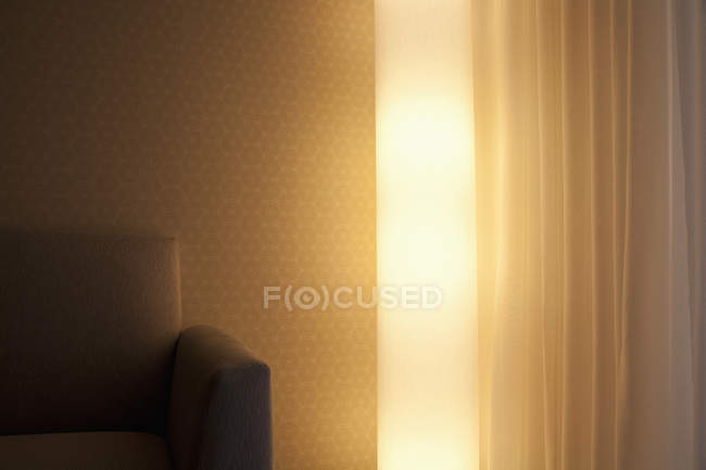 Detail of a light above sofa and curtain in living room — Stock Photo