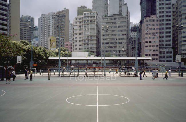 City basketball courts on background of apartment blocks — Stock Photo