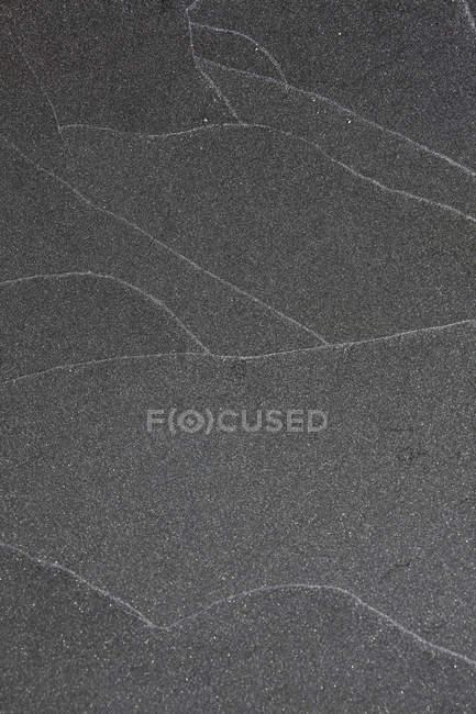 Plein cadre tiré d'asphalte fissuré — Photo de stock