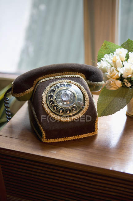 Close up view of retro telephone on table — Stock Photo