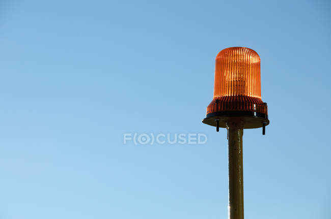 Warning light with blue background of sky — Stock Photo