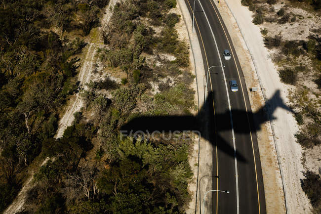 Aerial view of countryside highway and shadow of plane — Stock Photo