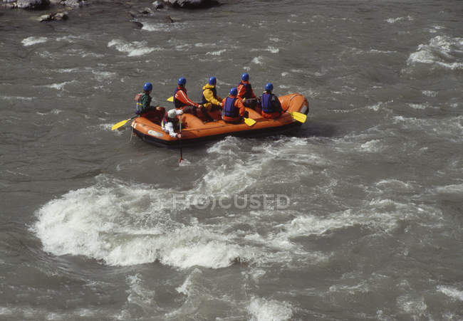 Group of people white water rafting on rapids — Stock Photo