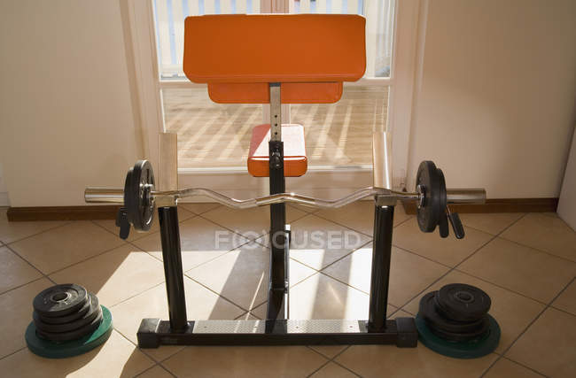 Barbell and bench set at home — Stock Photo