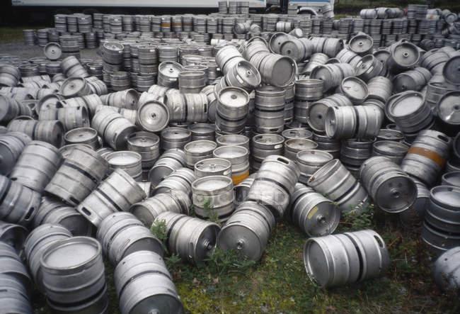 Pile of empty beer kegs at yard — Stock Photo