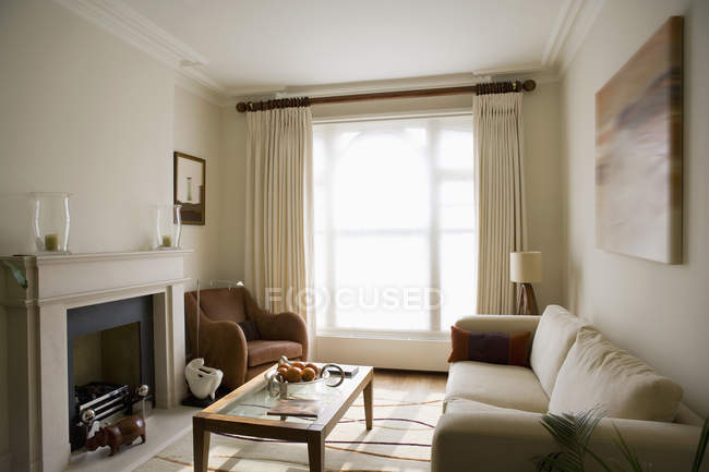 Sunlight shining through curtains to modern living room — Stock Photo