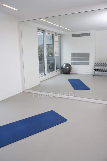 Empty gym with mirror reflecting interior u copy space healthy