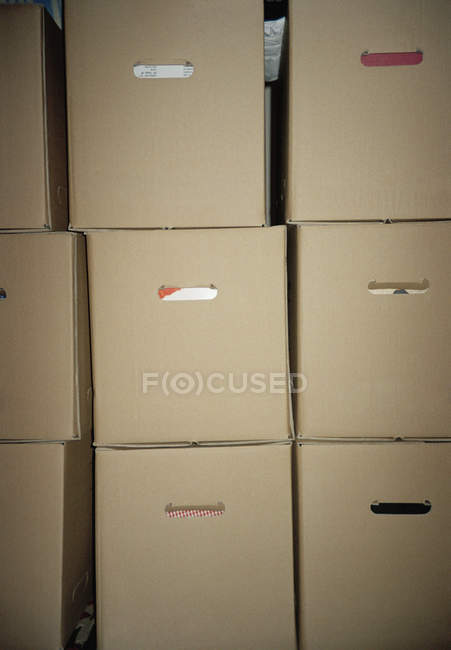 Full frame shot of stacked common cardboard boxes — Stock Photo