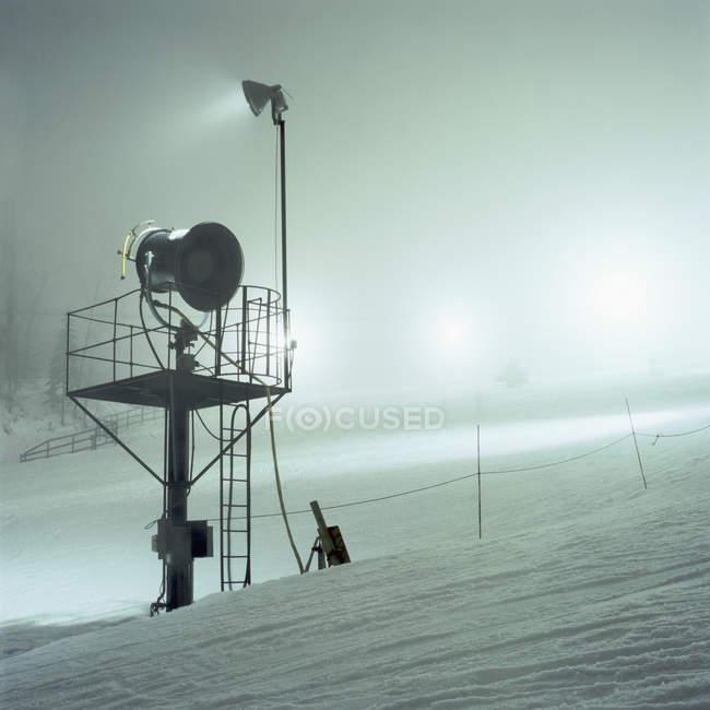 Spotlight on snow covered mountain slope — Stock Photo
