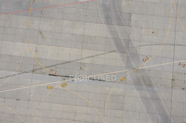 Aerial view of marking on empty airport tarmac — Stock Photo