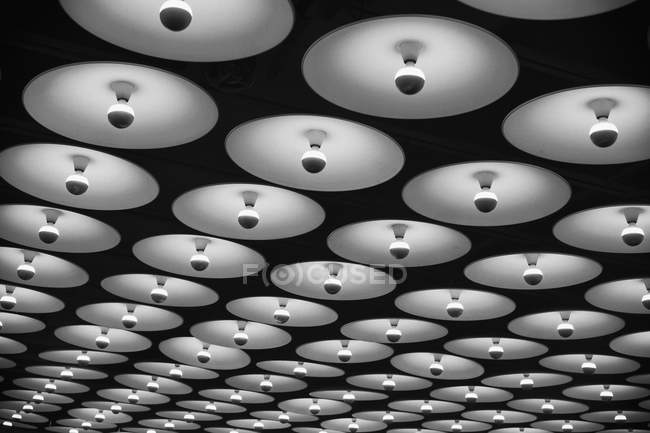 Low angle view to rows of ceiling lamps — Stock Photo