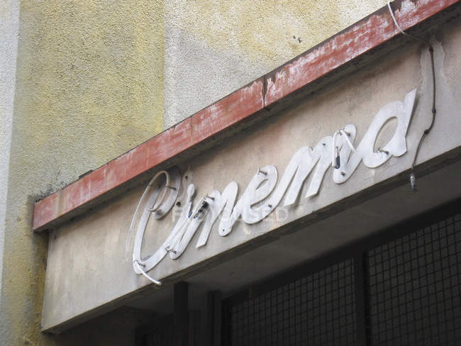 Cropped image of facade with old cinema sign — Stock Photo