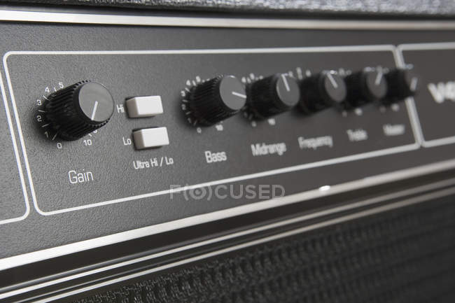 Close up view of knobs and buttons on guitar amplifier — Stock Photo