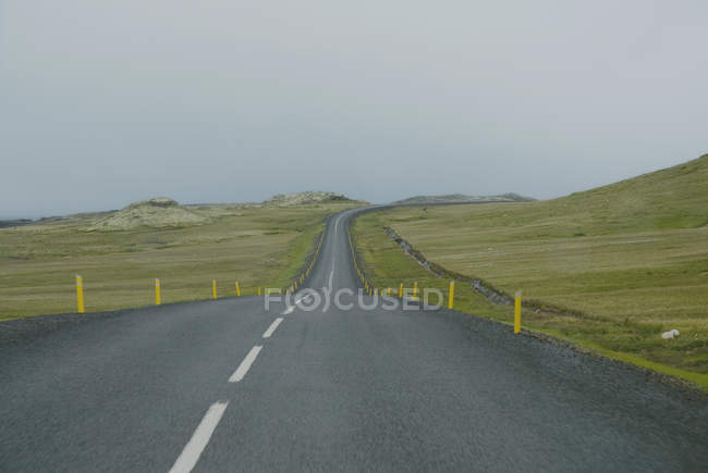 Road leading through foggy landscape in Iceland — Stock Photo