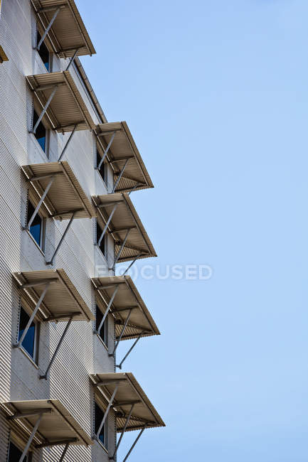 Building with open window shutters against sky — Stock Photo