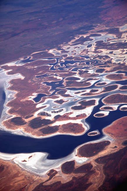 Luftaufnahme der Landschaft mit lockigem Fluss — Stockfoto