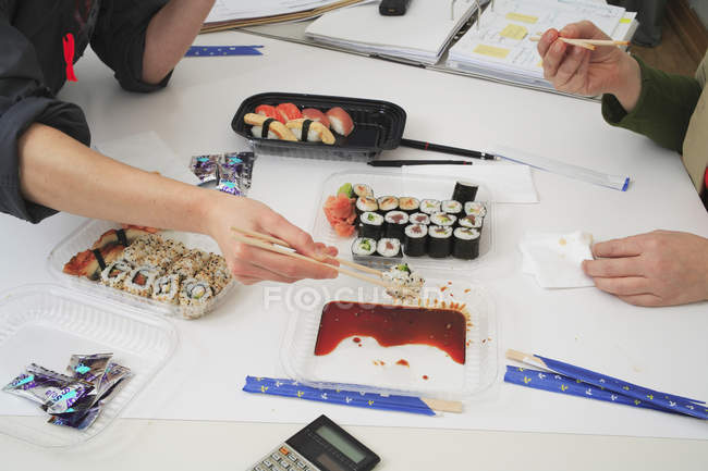 Sushi lunch at work — Stock Photo