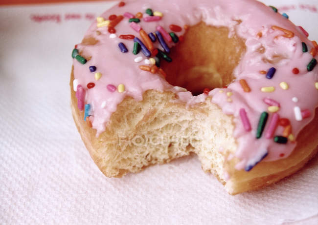 Close up view of doughnut with missing bite — Stock Photo
