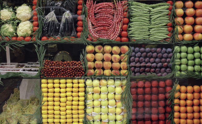 Directly above view of fruit and vegetables arranged in shop window — Stock Photo