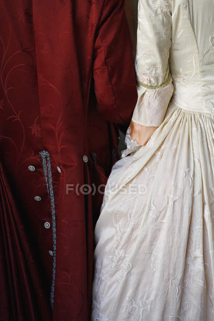 Rear view of two people wearing period costume — Stock Photo