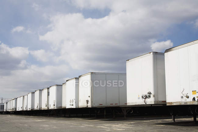 Rear view of cargo containers on lorries — Stock Photo