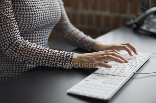 Midsection of woman typing on keyboard — Stock Photo