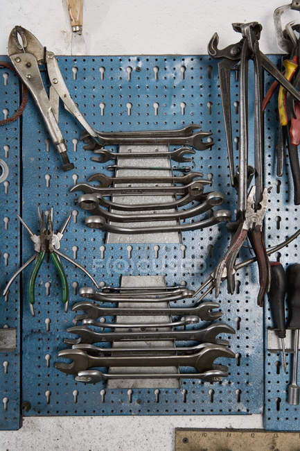 Manual tools hanging on workshop wall — Stock Photo