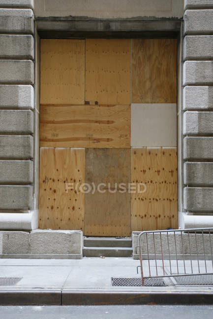 Building entrance blocked with wood boards — Stock Photo