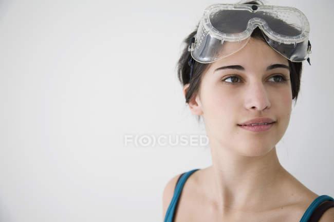 Teenage girl wearing protective glasses — Stock Photo