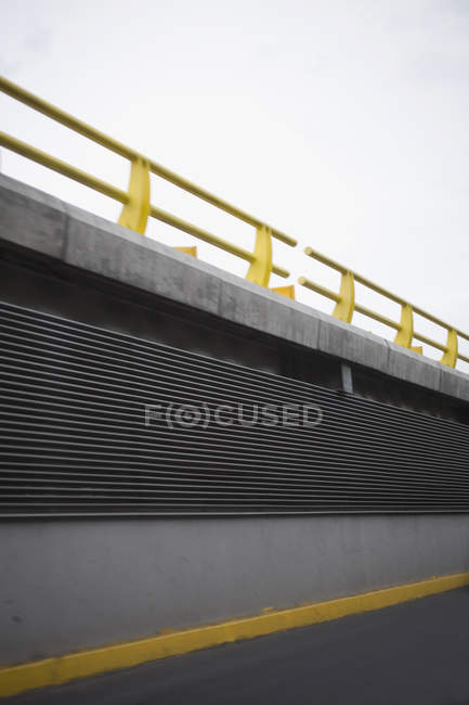 Side view of elevated road with yellow handrails — Stock Photo